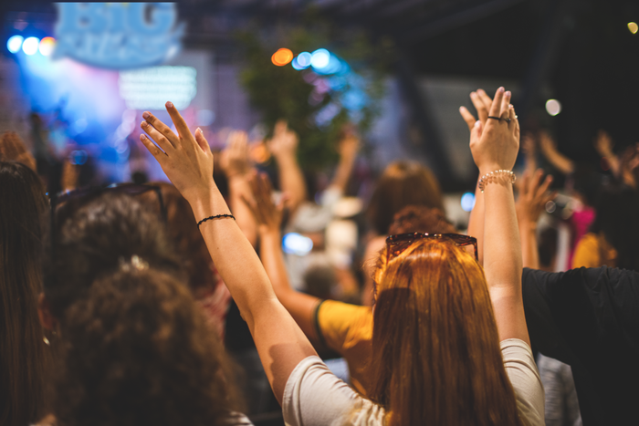church event - people with hands raised